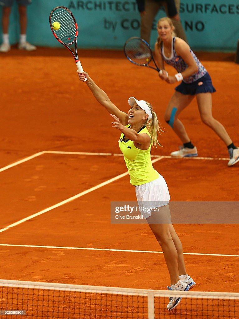 <a gi-track='captionPersonalityLinkClicked' href=/galleries/search?phrase=Elena+Vesnina&family=editorial&specificpeople=552598 ng-click='$event.stopPropagation()'>Elena Vesnina</a> and <a gi-track='captionPersonalityLinkClicked' href=/galleries/search?phrase=Ekaterina+Makarova&family=editorial&specificpeople=2364239 ng-click='$event.stopPropagation()'>Ekaterina Makarova</a> of Russia in action against Caroline Garcia and Kristina Mladenovic of France in their doubles semi final match during day seven of the Mutua Madrid Open tennis tournament at the Caja Magica on May 06, 2016 in Madrid,Spain.