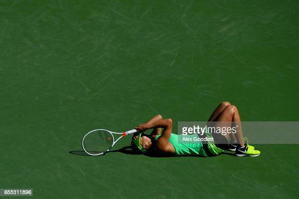 Elena Vesnina of Russia celebrates after defeating Svetlana Kuznetsova of Russia in the women's final on day 14 during the BNP Paribas Open at Indian...