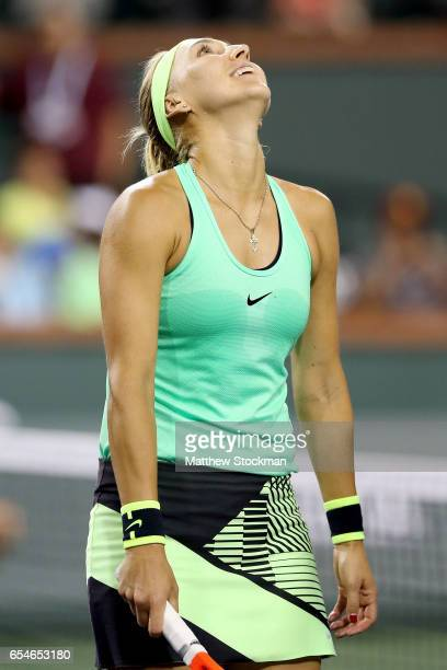 Elena Vesnina of Russia celebrates her win over Kristina Mladenovic of France during the semifinals of the BNP Paribas Open at the Indian Wells...