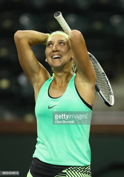 Elena Vesnina of Russia celebrates match point against Angelique Kerber of Germany in their fourth round match during day nine of the BNP Paribas...