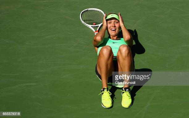 Elena Vesnina of Russia celebrates match point against Svetlana Kuznetsova of Russia in the womens final during day fourteen of the BNP Paribas Open...