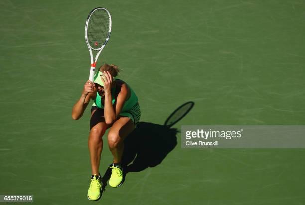 Elena Vesnina of Russia celebrates match point against Svetlana Kuznetsova of Russia in the womens final during day fourteen of the BNP Paribas Open...