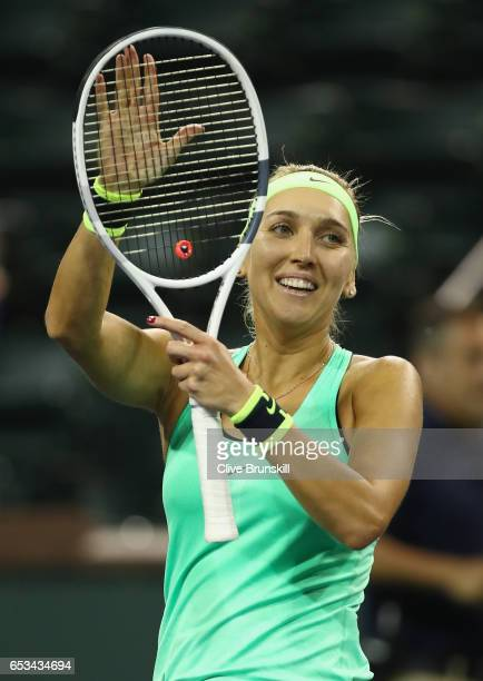 Elena Vesnina of Russia celebrates to the crowd after her straight sets victory against Angelique Kerber of Germany in their fourth round match...