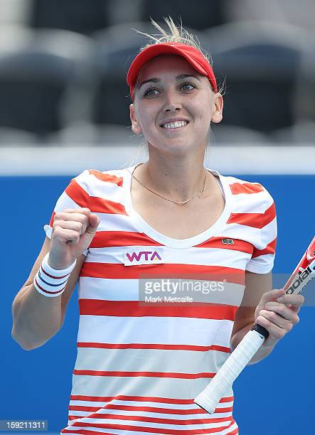 Elena Vesnina of Russia celebrates winning match point in her quarter final match against Jarmila Gajdosova of Australia during day seven of the...