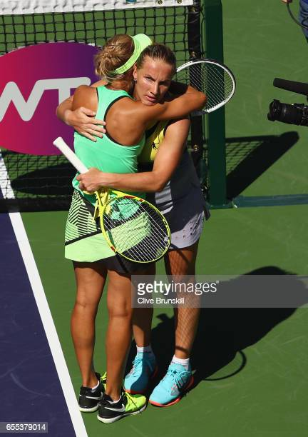 Elena Vesnina of Russia embraces at the net after her three set victory against Svetlana Kuznetsova of Russia in the womens final during day fourteen...