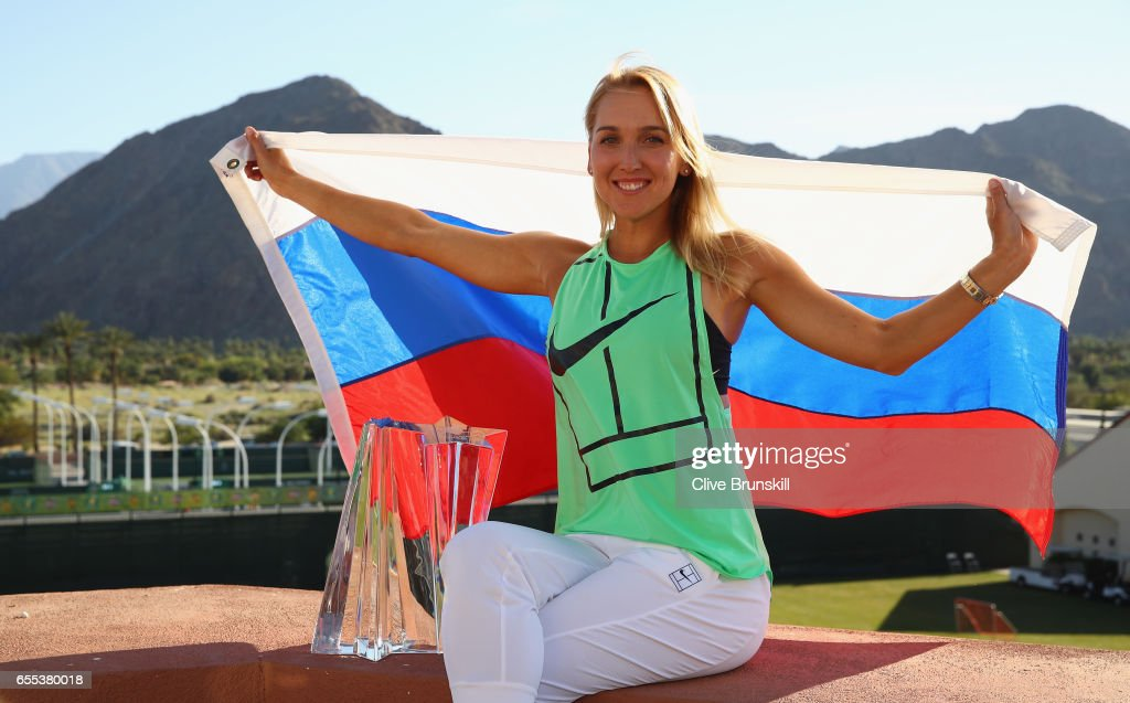 Elena Vesnina of Russia holds the Russian flag along with her trophy as she poses for photographs after her three set victory against Svetlana Kuznetsova of Russia in the womens final during day fourteen of the BNP Paribas Open at Indian Wells Tennis Garden on March 19, 2017 in Indian Wells, California.