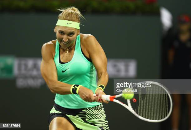 Elena Vesnina of Russia plays a backhand against Angelique Kerber of Germany in their fourth round match during day nine of the BNP Paribas Open at...