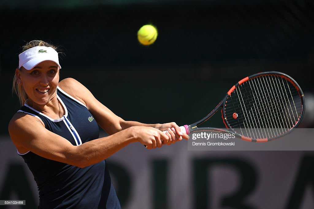 <a gi-track='captionPersonalityLinkClicked' href=/galleries/search?phrase=Elena+Vesnina&family=editorial&specificpeople=552598 ng-click='$event.stopPropagation()'>Elena Vesnina</a> of Russia plays a backhand during the Women's Singles second round match against Shelby Rogers of the United States at Roland Garros on May 25, 2016 in Paris, France.