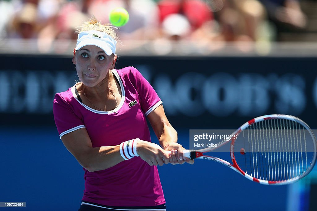 Elena Vesnina of Russia plays a backhand in her third round match against Roberta Vinci of Italy during day six of the 2013 Australian Open at Melbourne Park on January 19, 2013 in Melbourne, Australia.