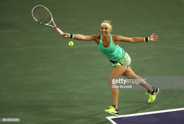 Elena Vesnina of Russia plays a forehand against Kristina Mladenovic of France in their semi final match during day twelve of the BNP Paribas Open at...