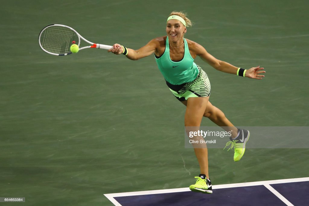 Elena Vesnina of Russia plays a forehand against Kristina Mladenovic of France in their semi final match during day twelve of the BNP Paribas Open at Indian Wells Tennis Garden on March 17, 2017 in Indian Wells, California.