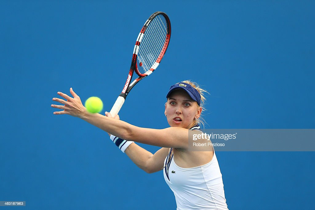 <a gi-track='captionPersonalityLinkClicked' href=/galleries/search?phrase=Elena+Vesnina&family=editorial&specificpeople=552598 ng-click='$event.stopPropagation()'>Elena Vesnina</a> of Russia plays a forehand in her first round doubles match with Ekaterina Makarova of Russia against Lauren Davis of the United States and Lourdes Dominguez Lino of Spain during day five of the 2014 Australian Open at Melbourne Park on January 17, 2014 in Melbourne, Australia.