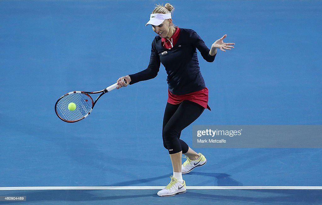 <a gi-track='captionPersonalityLinkClicked' href=/galleries/search?phrase=Elena+Vesnina&family=editorial&specificpeople=552598 ng-click='$event.stopPropagation()'>Elena Vesnina</a> of Russia plays a forehand in her first round match against Monica Puig of Puerto Rico during day two of the Moorilla Hobart International at Domain Tennis Centre on January 6, 2014 in Hobart, Australia.