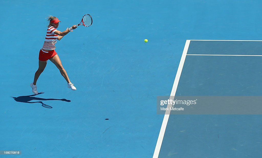 <a gi-track='captionPersonalityLinkClicked' href=/galleries/search?phrase=Elena+Vesnina&family=editorial&specificpeople=552598 ng-click='$event.stopPropagation()'>Elena Vesnina</a> of Russia plays a forehand in her semi final match against Sloane Stephens of the USA during day eight of the Hobart International at Domain Tennis Centre on January 11, 2013 in Hobart, Australia.