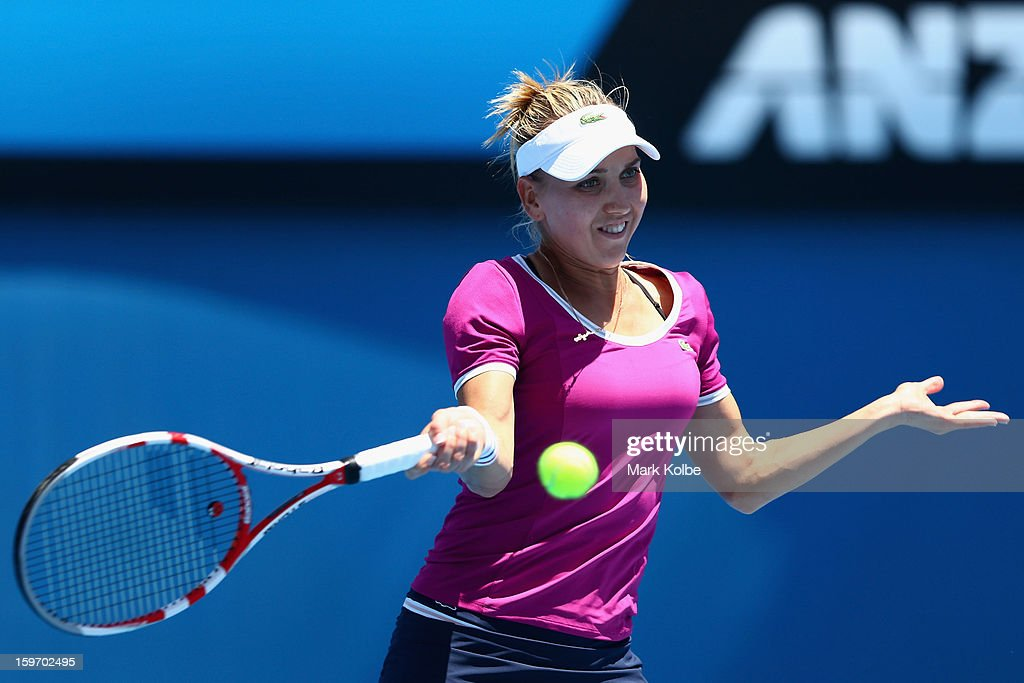 Elena Vesnina of Russia plays a forehand in her third round match against Roberta Vinci of Italy during day six of the 2013 Australian Open at Melbourne Park on January 19, 2013 in Melbourne, Australia.