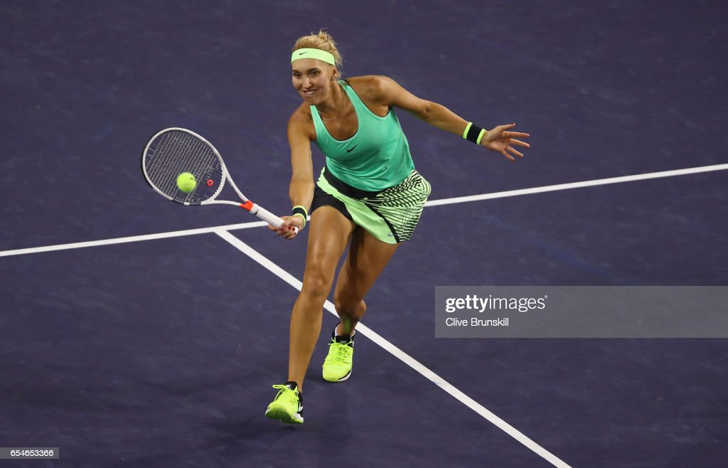Elena Vesnina of Russia plays a forehand volley against Kristina Mladenovic of France in their semi final match during day twelve of the BNP Paribas Open at Indian Wells Tennis Garden on March 17, 2017 in Indian Wells, California.