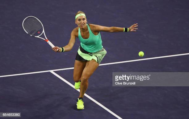 Elena Vesnina of Russia plays a forehand volley against Kristina Mladenovic of France in their semi final match during day twelve of the BNP Paribas...