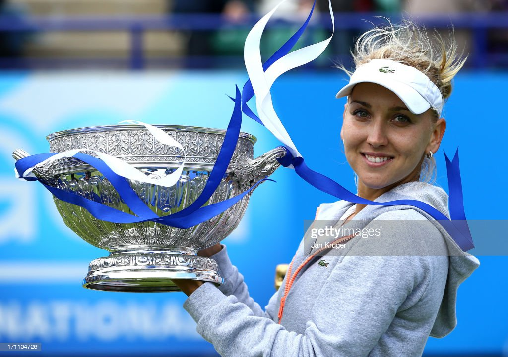 <a gi-track='captionPersonalityLinkClicked' href=/galleries/search?phrase=Elena+Vesnina&family=editorial&specificpeople=552598 ng-click='$event.stopPropagation()'>Elena Vesnina</a> of Russia poses with the trophy after defeating Jamie Hampton of the USA in the women's singles final match during the day eight of the AEGON International tennis tournament at Devonshire Park on June 22, 2013 in Eastbourne, England.