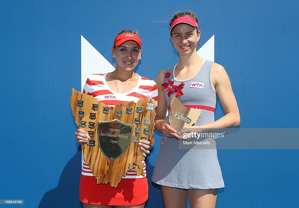 Elena Vesnina of Russia poses with the winners trophy and Mona Barthel of Germany poses with the runner's up trophy after the singles final match during day nine of the Hobart International at Domain Tennis Centre on January 12, 2013 in Hobart, Australia.