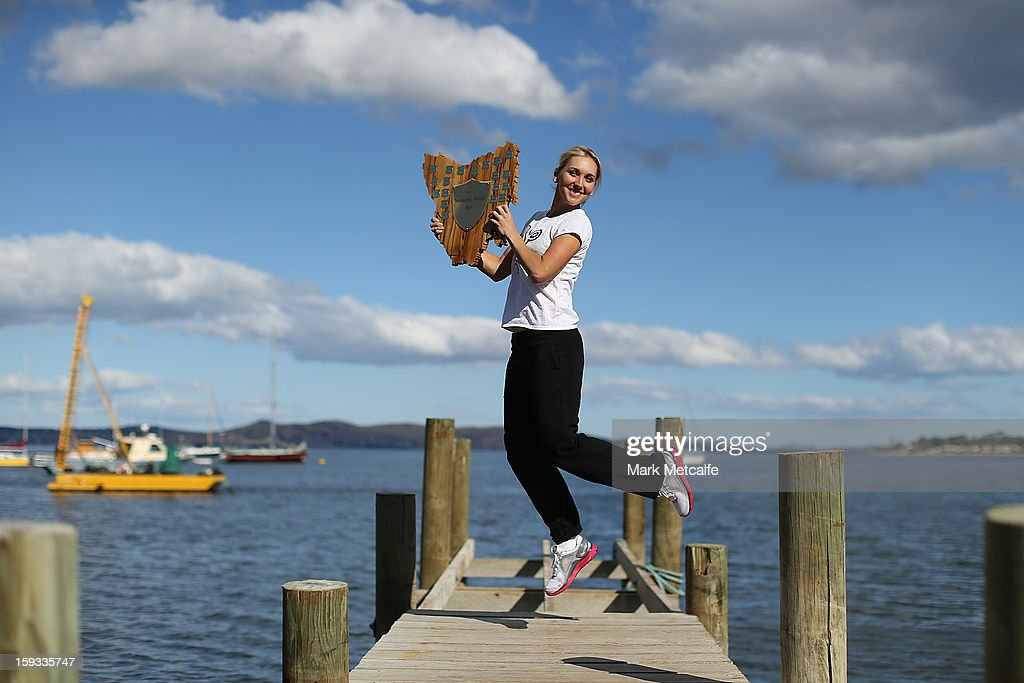 Elena Vesnina of Russia poses with the winners trophy on a visit to Battery Point after victory in the Women's singles final match against Mona Barthel of Germany during day nine of the Hobart International at Domain Tennis Centre on January 12, 2013 in Hobart, Australia.