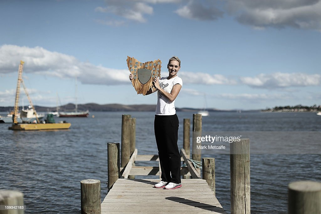 <a gi-track='captionPersonalityLinkClicked' href=/galleries/search?phrase=Elena+Vesnina&family=editorial&specificpeople=552598 ng-click='$event.stopPropagation()'>Elena Vesnina</a> of Russia poses with the winners trophy on a visit to Battery Point after victory in the Women's singles final match against Mona Barthel of Germany during day nine of the Hobart International at Domain Tennis Centre on January 12, 2013 in Hobart, Australia.