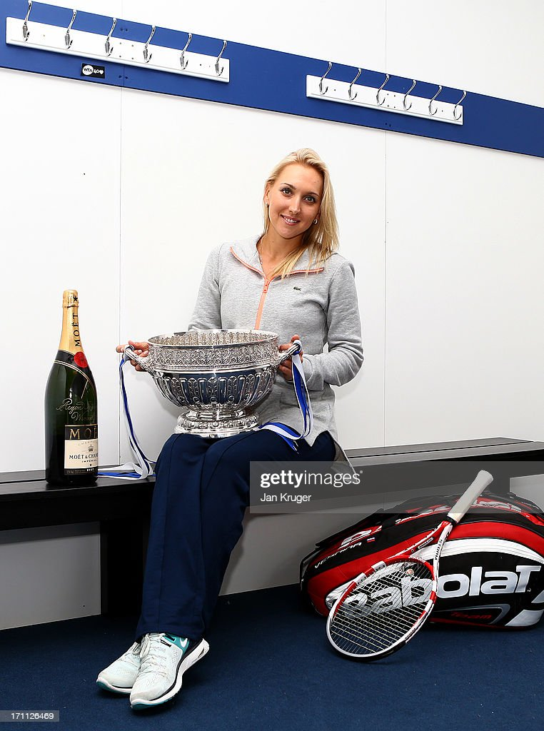 <a gi-track='captionPersonalityLinkClicked' href=/galleries/search?phrase=Elena+Vesnina&family=editorial&specificpeople=552598 ng-click='$event.stopPropagation()'>Elena Vesnina</a> of Russia poses with the women's singles trophy after defeating Jamie Hampton of the USA on day eight of the AEGON International tennis tournament at Devonshire Park on June 22, 2013 in Eastbourne, England.
