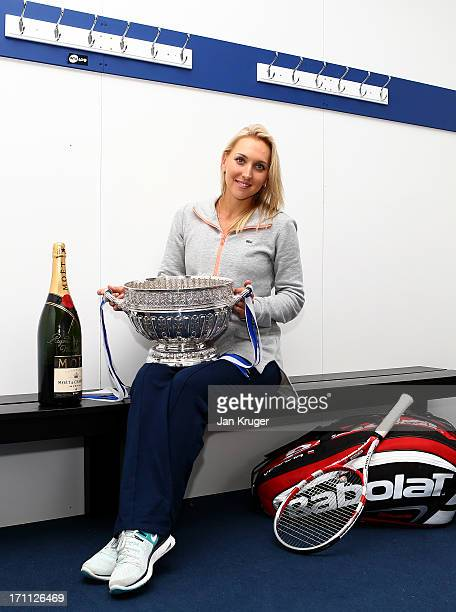 Elena Vesnina of Russia poses with the women's singles trophy after defeating Jamie Hampton of the USA on day eight of the AEGON International tennis...