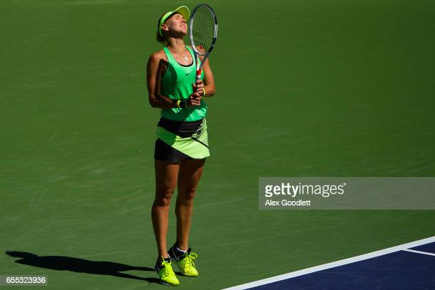 Elena Vesnina of Russia reacts to a shot against Svetlana Kuznetsova of Russia in the women's final on day 14 during the BNP Paribas Open at Indian...