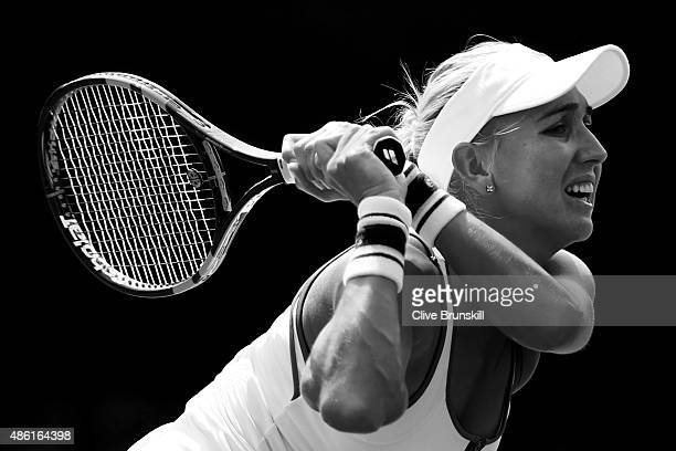 Elena Vesnina of Russia returns a shot against Laura Robson of Great Britain during their Women's Singles First Round match on Day Two of the 2015 US...