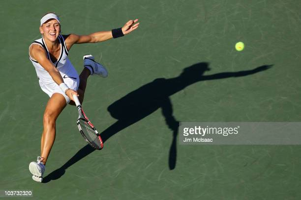Elena Vesnina of Russia returns a shot against Samantha Stosur of Australia during the Women's Singles first round match on day one of the 2010 US...