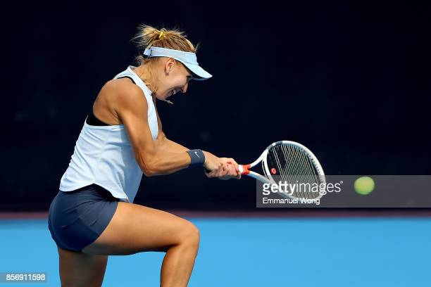 Elena Vesnina of Russia returns a shot against YingYing Duan of China on day four of the 2017 China Open at the China National Tennis Centre on...