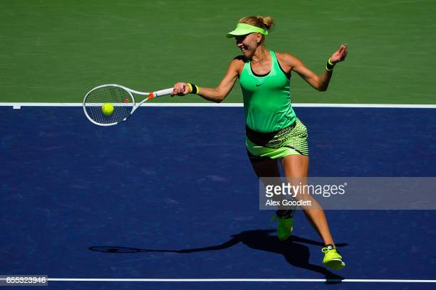 Elena Vesnina of Russia returns a shot to Svetlana Kuznetsova of Russia in the women's final on day 14 during the BNP Paribas Open at Indian Wells...