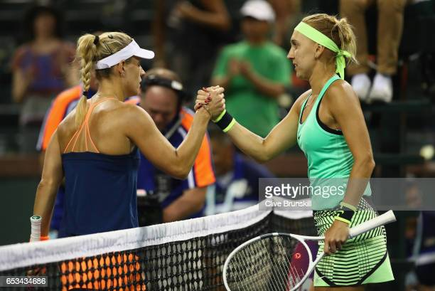Elena Vesnina of Russia shakes hands at the net after her straight sets victory against Angelique Kerber of Germany in their fourth round match...