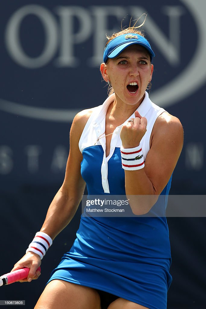 Elena Vesnina of Russian celebrates winning the first set during her women's singles first round match against Shuai Peng of China during Day Two of the 2012 US Open at USTA Billie Jean King National Tennis Center on August 28, 2012 in the Flushing neigborhood of the Queens borough of New York City.