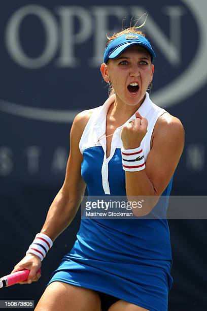 Elena Vesnina of Russian celebrates winning the first set during her women's singles first round match against Shuai Peng of China during Day Two of...