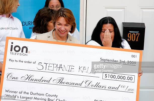 Eleo Hensleigh chief marketing officer for ION Media Networks and Stephanie Kelly 42 of Kearny NJ celebrate Stephanie Kelly's winning of $100000...