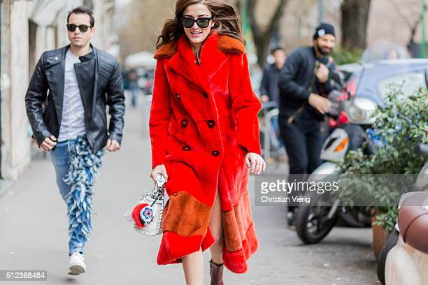 Eleonora Carisi is wearing a red Fendi coat seen outside Fendi during Milan Fashion Week Fall/Winter 2016/17 on February 25 in Milan Italy