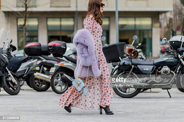 Eleonora Carisi wearing a dress with floral print a Valentino bag Fendi shoes and a purple fur coat seen outside Costume National during Milan...