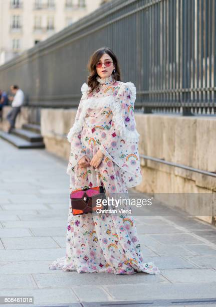 Eleonora Carisi wearing a sheer dress with print outside Ulyana Sergeenko during Paris Fashion Week Haute Couture Fall/Winter 20172018 Day Three on...