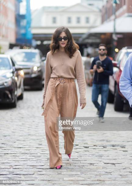Eleonora Carisi wearing brown knit pants seen in the streets of Manhattan outside Tibi during New York Fashion Week on September 9 2017 in New York...