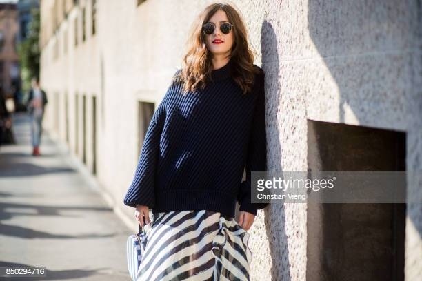 Eleonora Carisi wearing navy knit striped skirt is seen outside Alberta Ferretti during Milan Fashion Week Spring/Summer 2018 on September 20 2017 in...