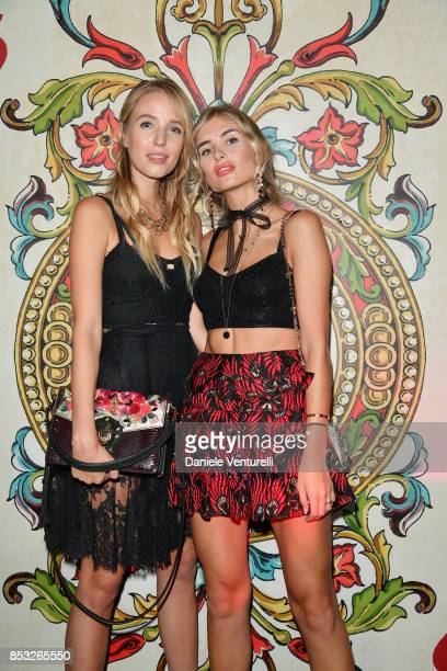 Eleonore Von Habsburg and a guest attend Dolce Gabbana Queen Of Hearts Party show during Milan Fashion Week Spring/Summer 2018 at on September 24...