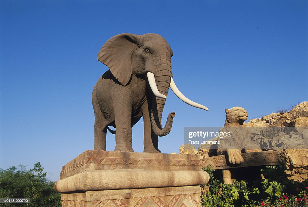 Elephant and Cheetah Statues
