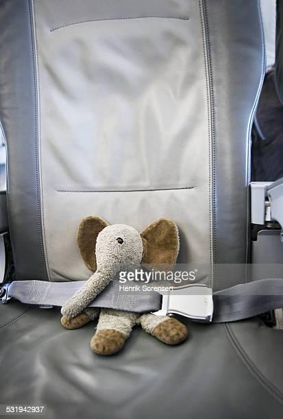 Elephant teddy on a plane seat