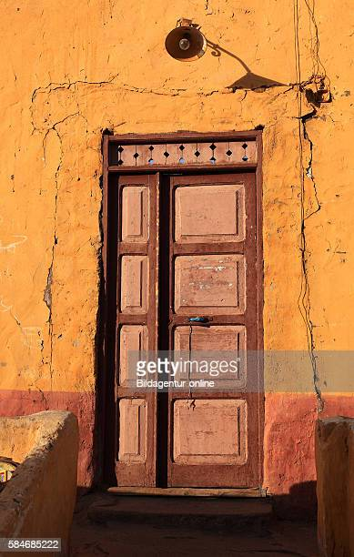 Elephantine Island House facade with lamp over the door in a Nubian village Upper Egypt