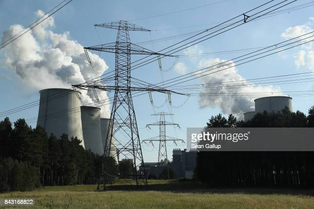 Eletricity pylons stand near cooling towers at the Jaenschwalde coalfired power plant on September 5 2017 near Peitz Germany Germany is making strong...