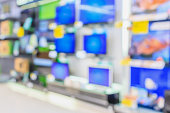 eletronic department store with Television shelves blurred background..