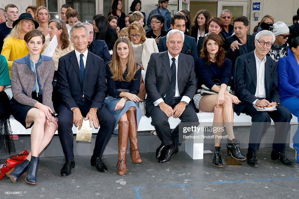Elettra Rossellini, CEO Chloe, Geoffroy de La Bourdonnais, Olivia Palermo, Co-Chief Executive Officer of Richemont Bernard Fornas, Gemma Arterton and Didier Grumbach attend Chloe show as part of the Paris Fashion Week Womenswear Spring/Summer 2014, held at Lycee Carnot on September 29, 2013 in Paris, France.
