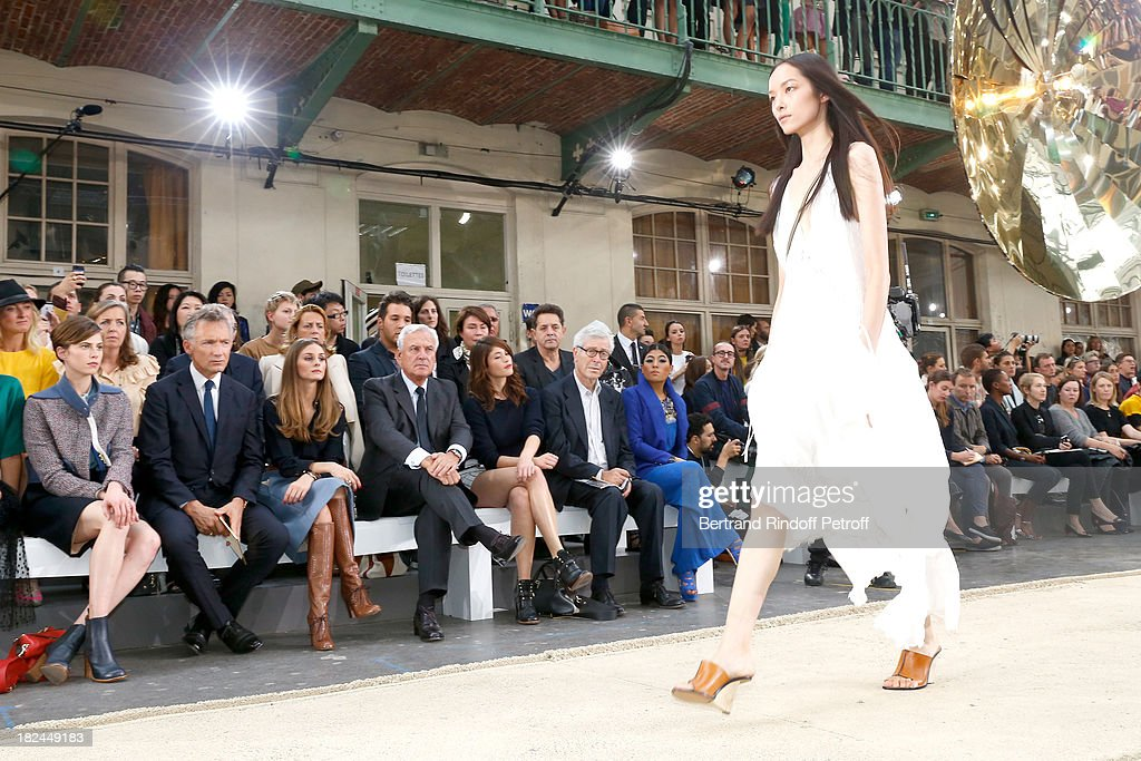 Elettra Rossellini, CEO Chloe, Geoffroy de La Bourdonnais, Olivia Palermo, Co-Chief Executive Officer of Richemont Bernard Fornas, Gemma Arterton, Didier Grumbach and Sirivannavari Nariratana attend Chloe show as part of the Paris Fashion Week Womenswear Spring/Summer 2014, held at Lycee Carnot on September 29, 2013 in Paris, France.