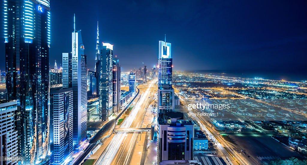 Elevated cityscape of Dubai illuminated at night : Foto de stock